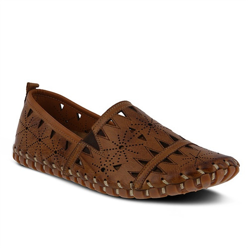 Brown leather slip on with geometric laser cut outs and rubber outsole.