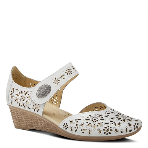 White mary jane wedge with perforated leather upper and ornate metal button.