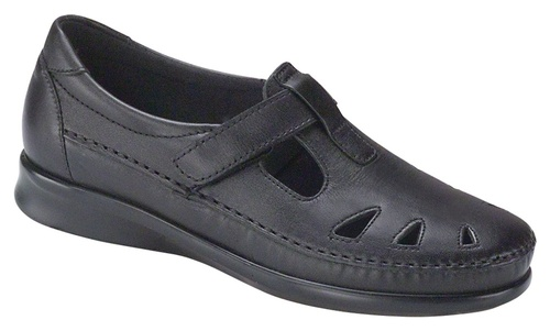 Black leather upper with adjustable leather strap by Sas.