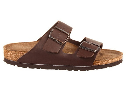 Brown synthetic leather two strap sandal with cork footbed by Birkenstock.