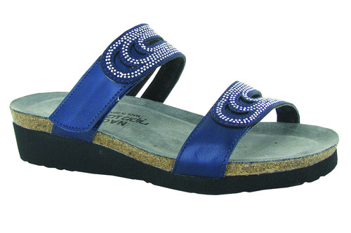 Navy slide sandal with rivet accents and cork footbed.