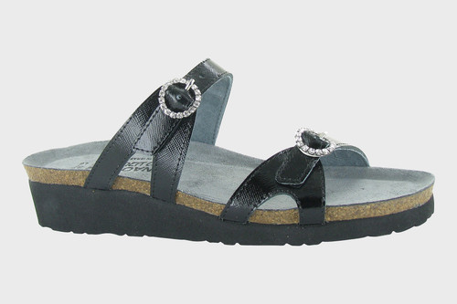 Black slide sandal with rhinestone buckles by Naot.
