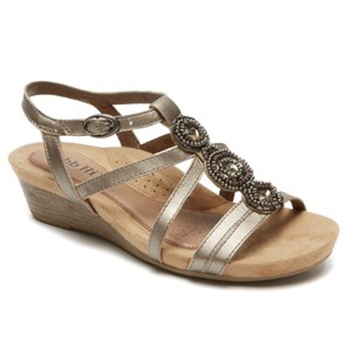 Pewter wedge sandal with decortive embleisments that can be dressed up or down by Rockport.