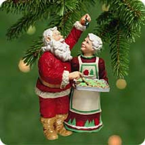2001 Santa Sneaks A Sweet Hallmark ornament