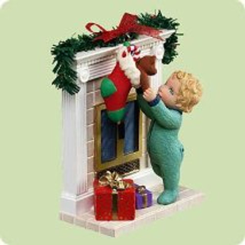 2004 Reaching For Christmas Hallmark ornament