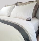 up close of pillow cases, shams, flat sheet