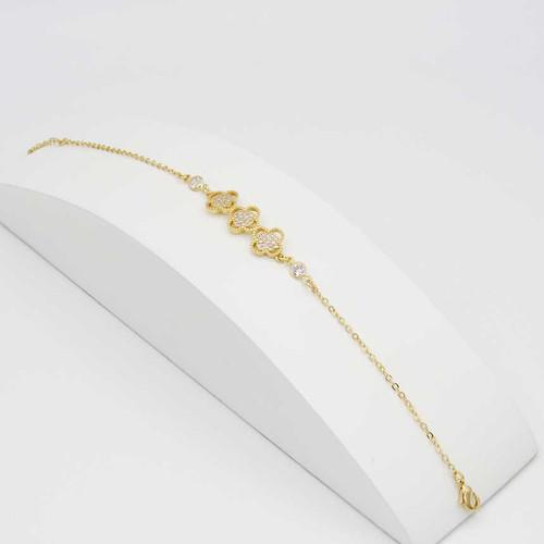 Pulseira banhada em ouro 18k 3 trevos cravejadas com zirconias brancas e ponto de luz branca 20cm + 5cm