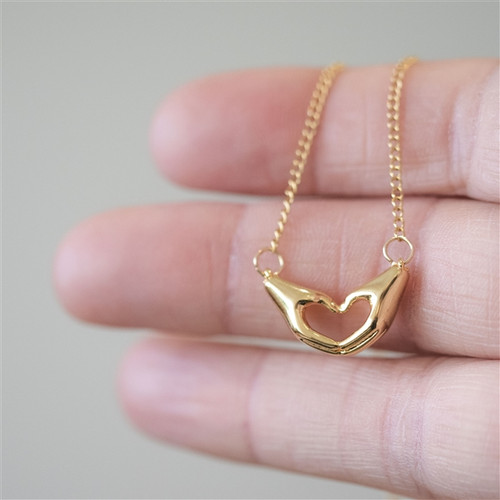 Gold heart hands love you necklace