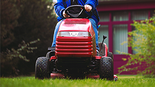 Man riding lawn tractor