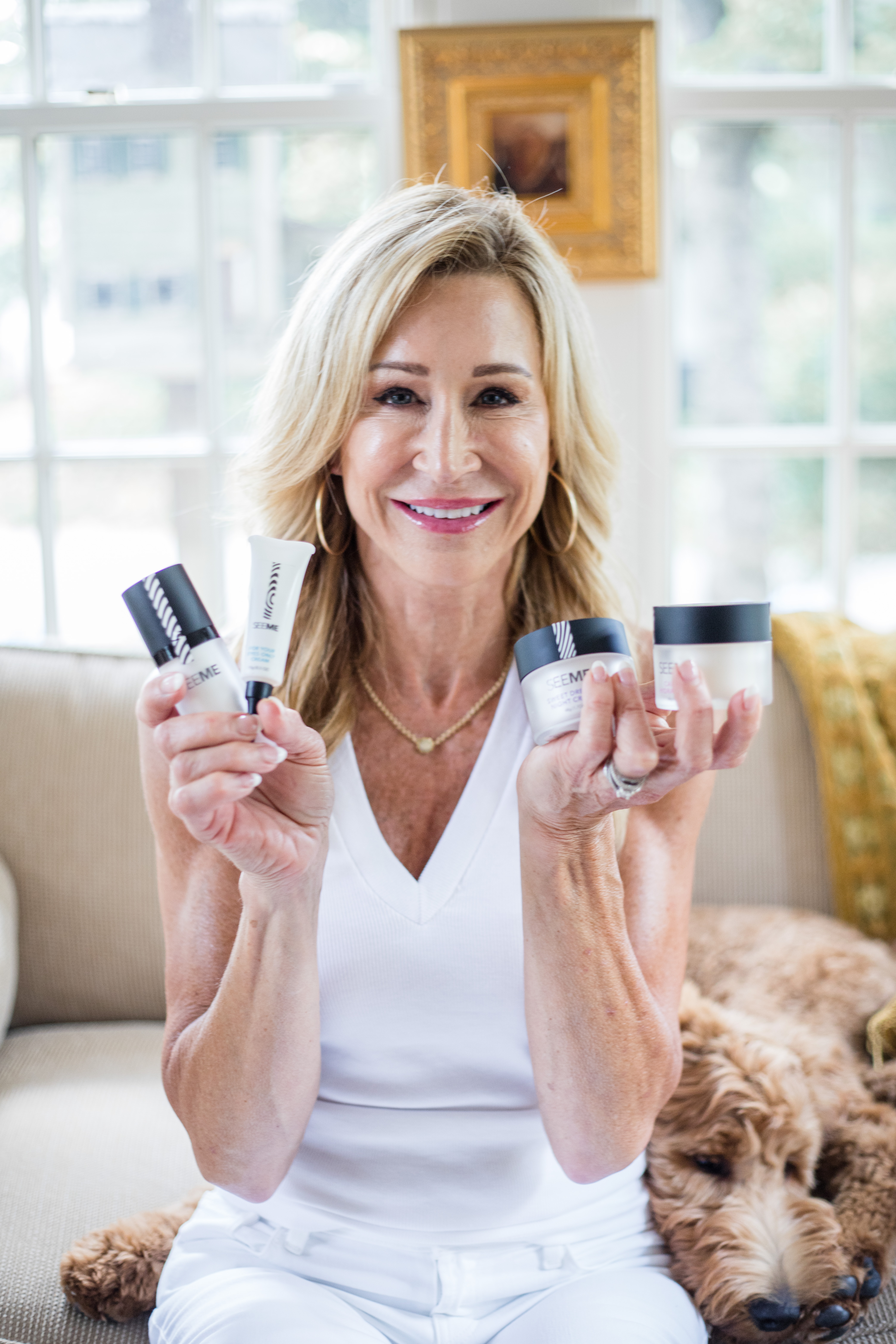 older model in white holding SeeMe Beauty Skin Care Kit products