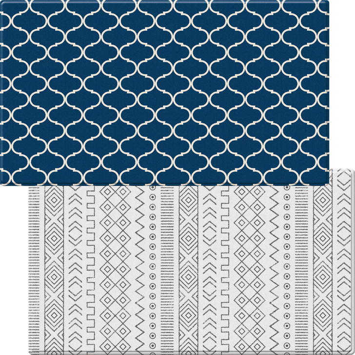 An image of a durable, luxurious reversible soft rug. Two sides -- one navy and white, the other white in a boho design.