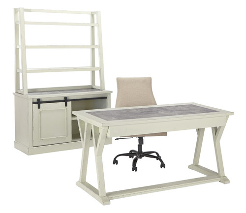 Desk features angled leg structure, three drawers and an inset faux cement top. Credenza features a faux cement top and sliding barn door with dark gray hardware concealing open shelving. Optional angled shelving hutch. Bar pull hardware has an industrial look with dark gray finish.