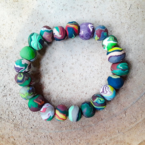 Handmade clay beaded bracelet set on an elastic band. Fits the average small woman's wrist. Each beaded bracelet is unique. The pictured bracelets are for display only.