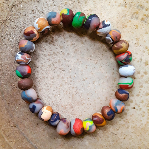 Handmade clay beaded bracelet set on an elastic band. Fits the average large man's wrist. Each beaded bracelet is unique. The pictured bracelets are for display only.