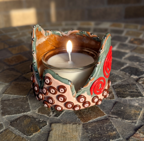 Handmade clay-wrapped specially shaped glass jar. Multiple uses including but not limited to candle holder. Purchase includes vanilla scented handmade candle.