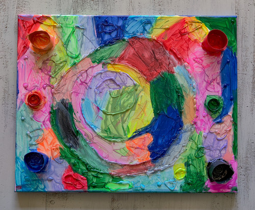 """Swirly Whirly was created using acrylic paint,  glue gun artwork, repurposed plastic lids recycled from water bottles, and repurposed cardboard recycled from household items.  16"""" x 20"""" canvas board"""