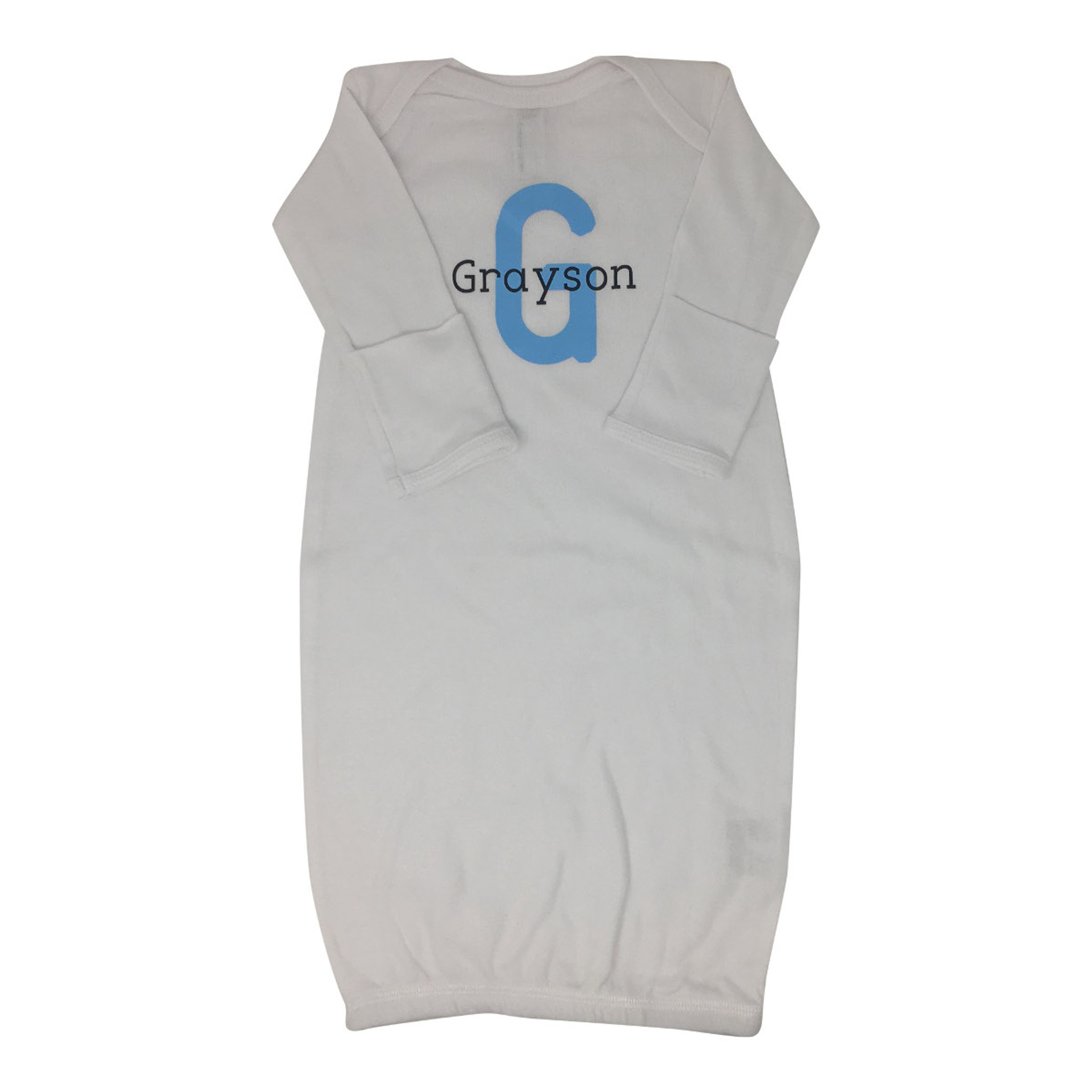 """A white baby onesie with the name """"Grayson"""" and a large blue letter """"G"""" inscribed on the chest."""