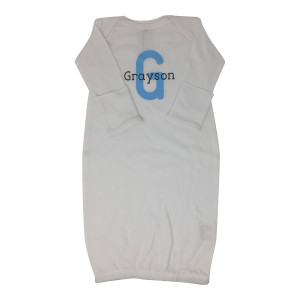 "A white baby onesie with the name ""Grayson"" and a large blue letter ""G"" inscribed on the chest."