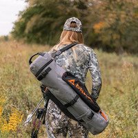 carrying a Chama All-Terrain Swivel Chair on the back