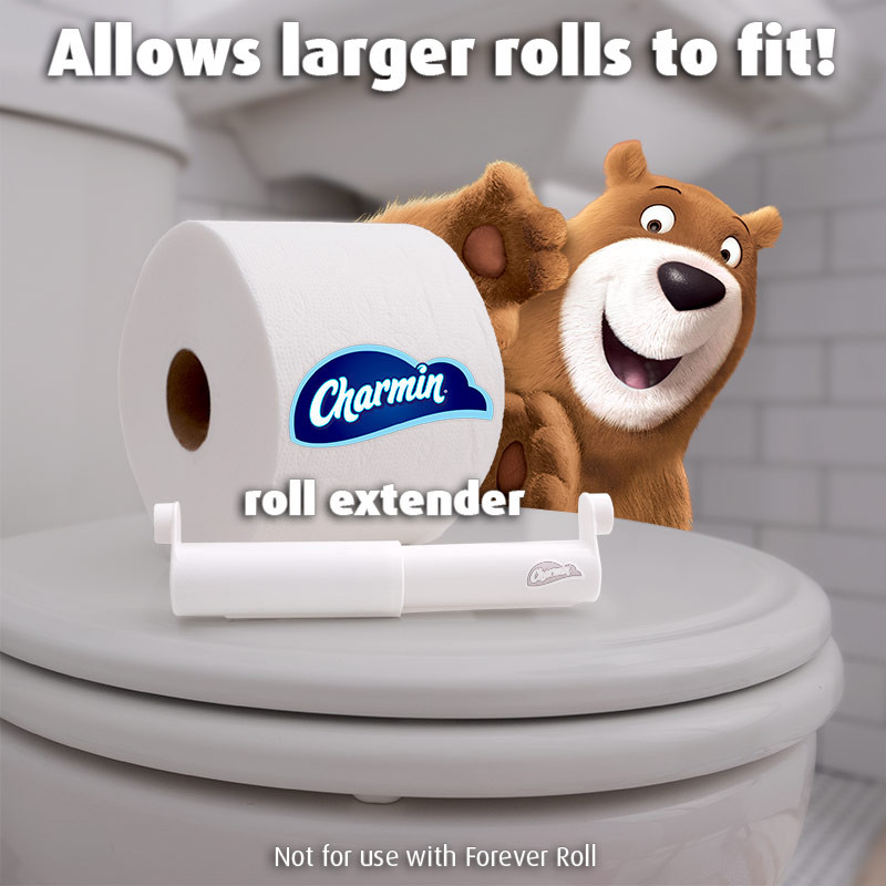 Leonard the bear is peaking around behind the Charmin Roll Extender with a large roll of Charmin next to him. Charmin Roll extenders can help hold larger rolls in your bathroom. It replaces the spindle of the roll holder you have to allow for larger rolls.