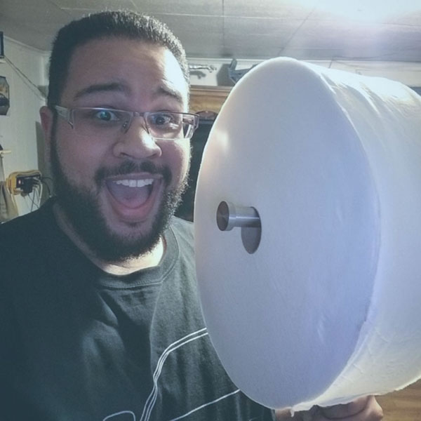 Surprised Man with Charmin Forever Roll