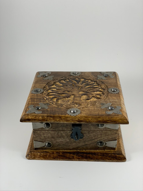 A beautiful chest-style box carved with the Tree of Life on the lid