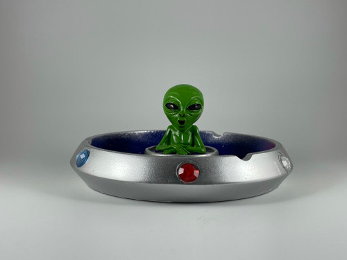 Alien in a spaceship round ashtray.