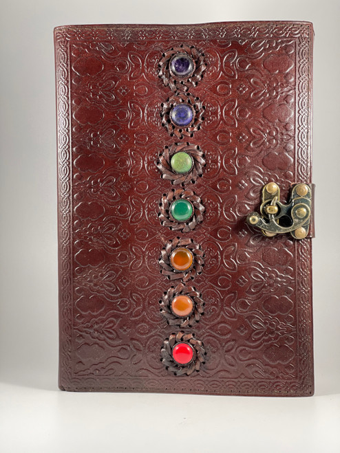 Large Leather Chakra Design Embossed Journal measures 7x10 inches. It has over 150 pages.
