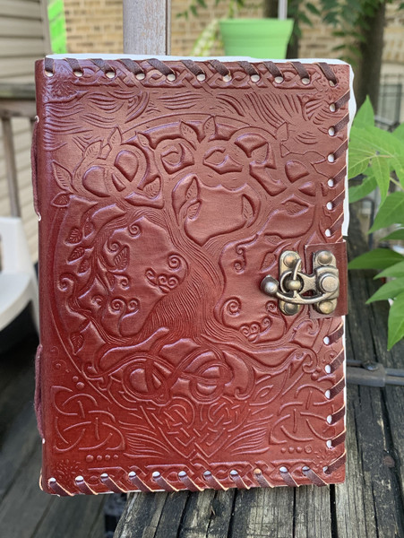 Beautiful handmade journal with an embossed Tree of Life. Size 5x7 inches with approximately 70 pages. The journal closes with a latch.