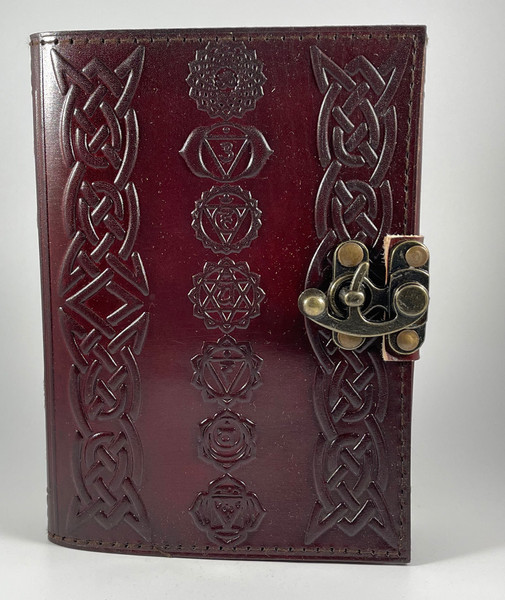 Chakras journal leather bound and stitched with metal lock.