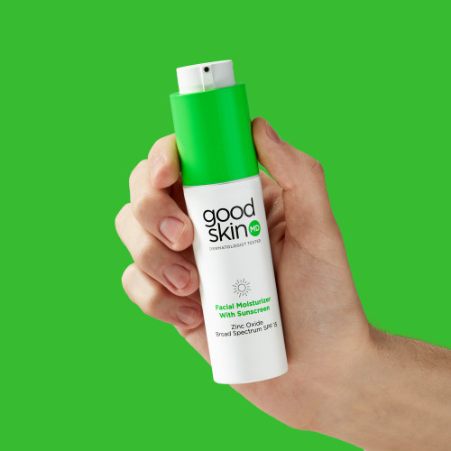 Facial Moisturizer with Sunscreen in Hand