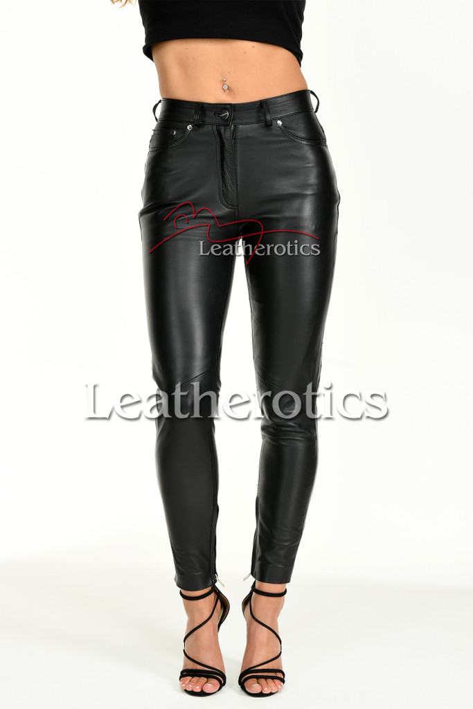 Tight leather trousers with ankle zipper
