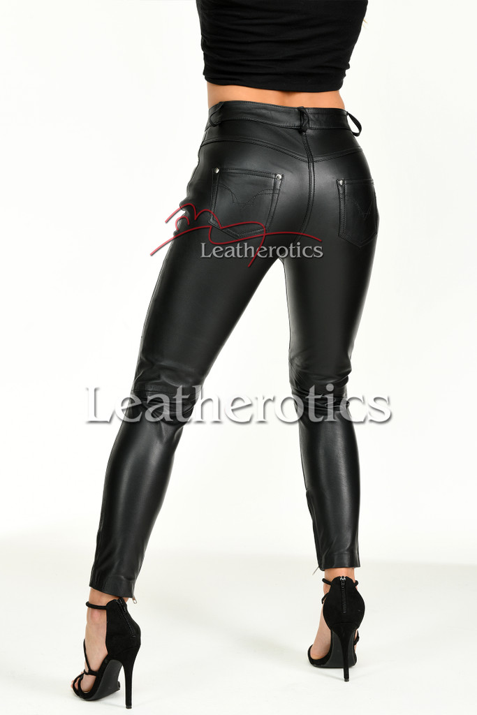Tight leather trousers with ankle zipper- back