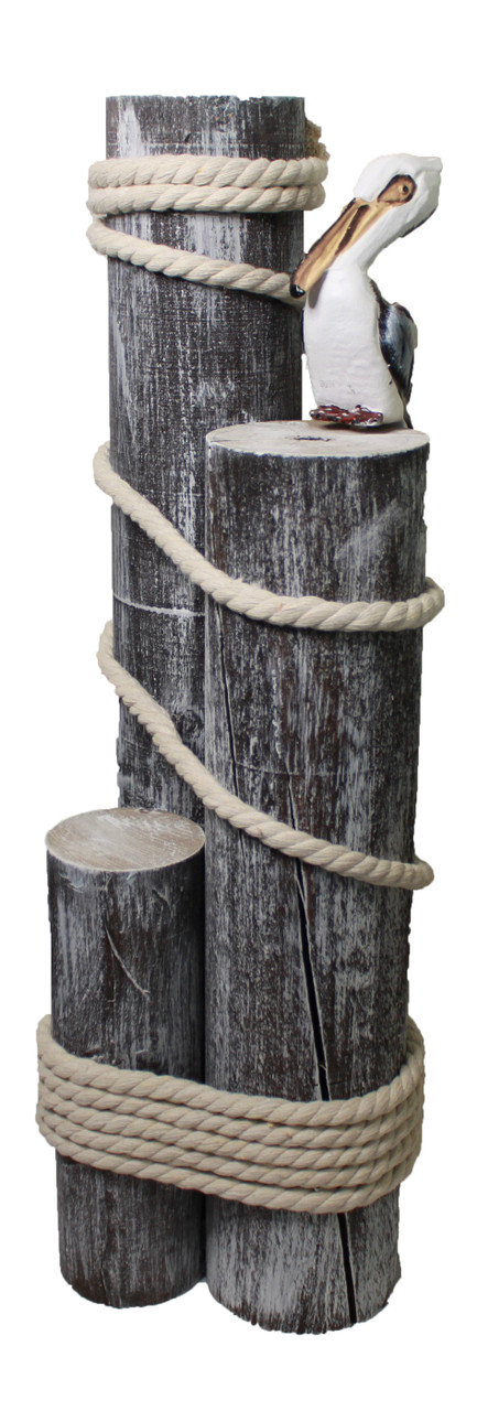 Wooden Pilings with Pelican and Rope