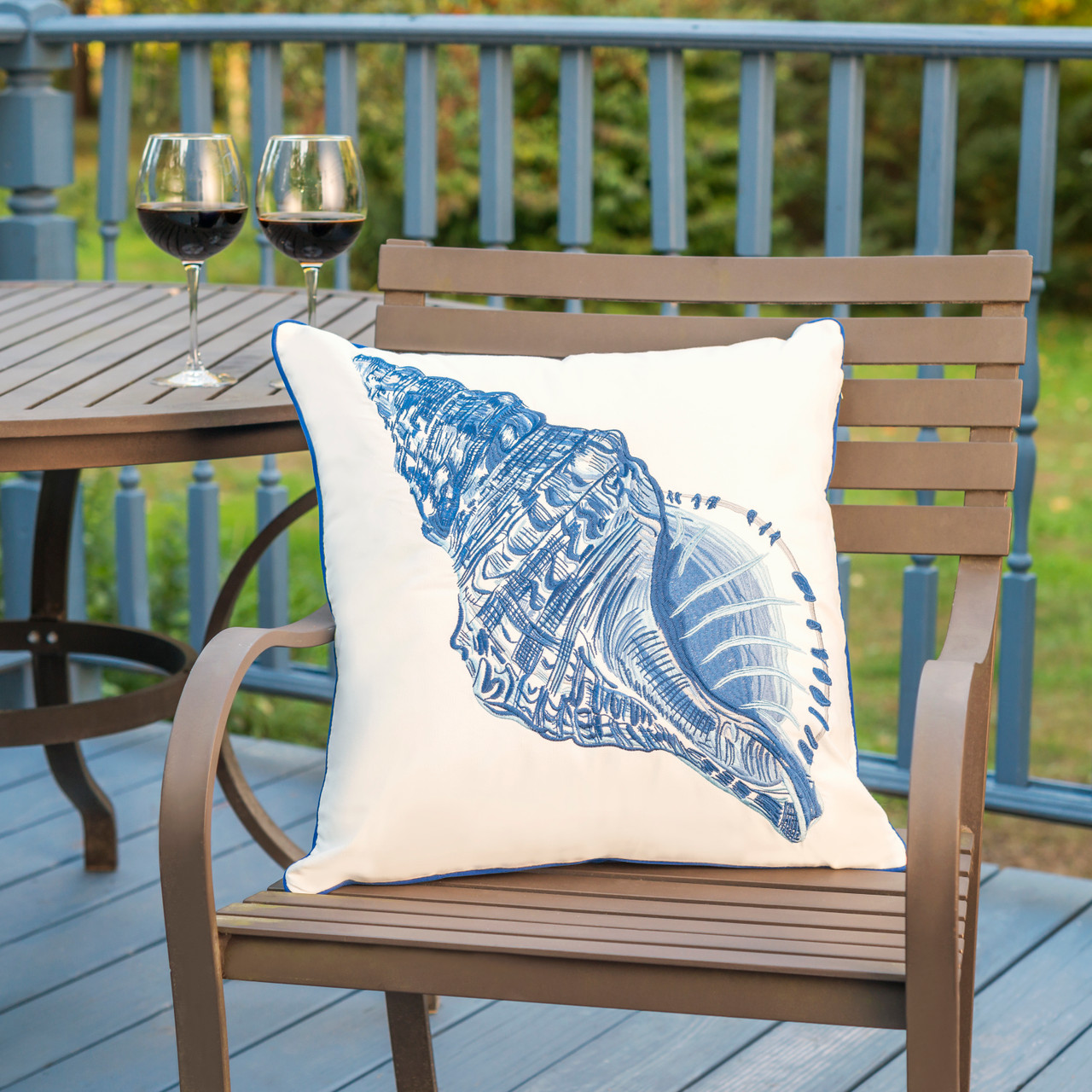 Blue Conch Shell Outdoor Throw Pillow with Sunbrella Fabric - Lifestyle