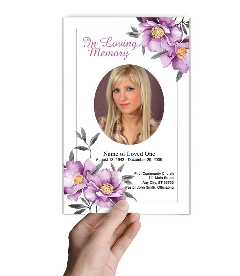 front.view.holding.bifold.funeral.program.site2.jpg