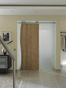 Modern barndoor hardware in stainless finish used for wood door in a home