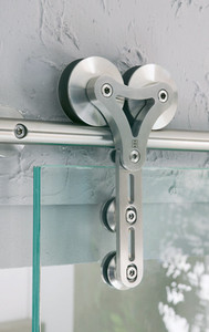 Stainless Barn door hardware kit installed on a glass barn door