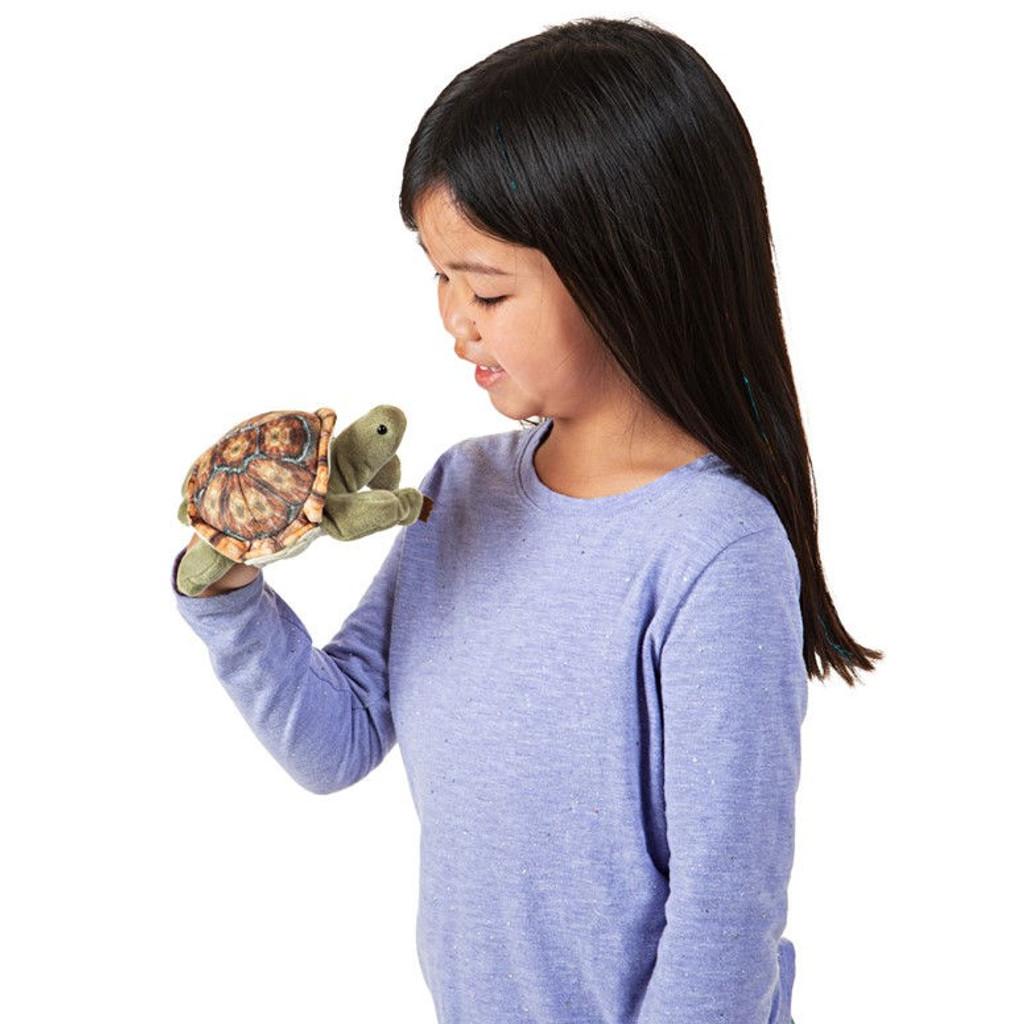 Folkmanis Mini Tortoise Finger Puppet with girl