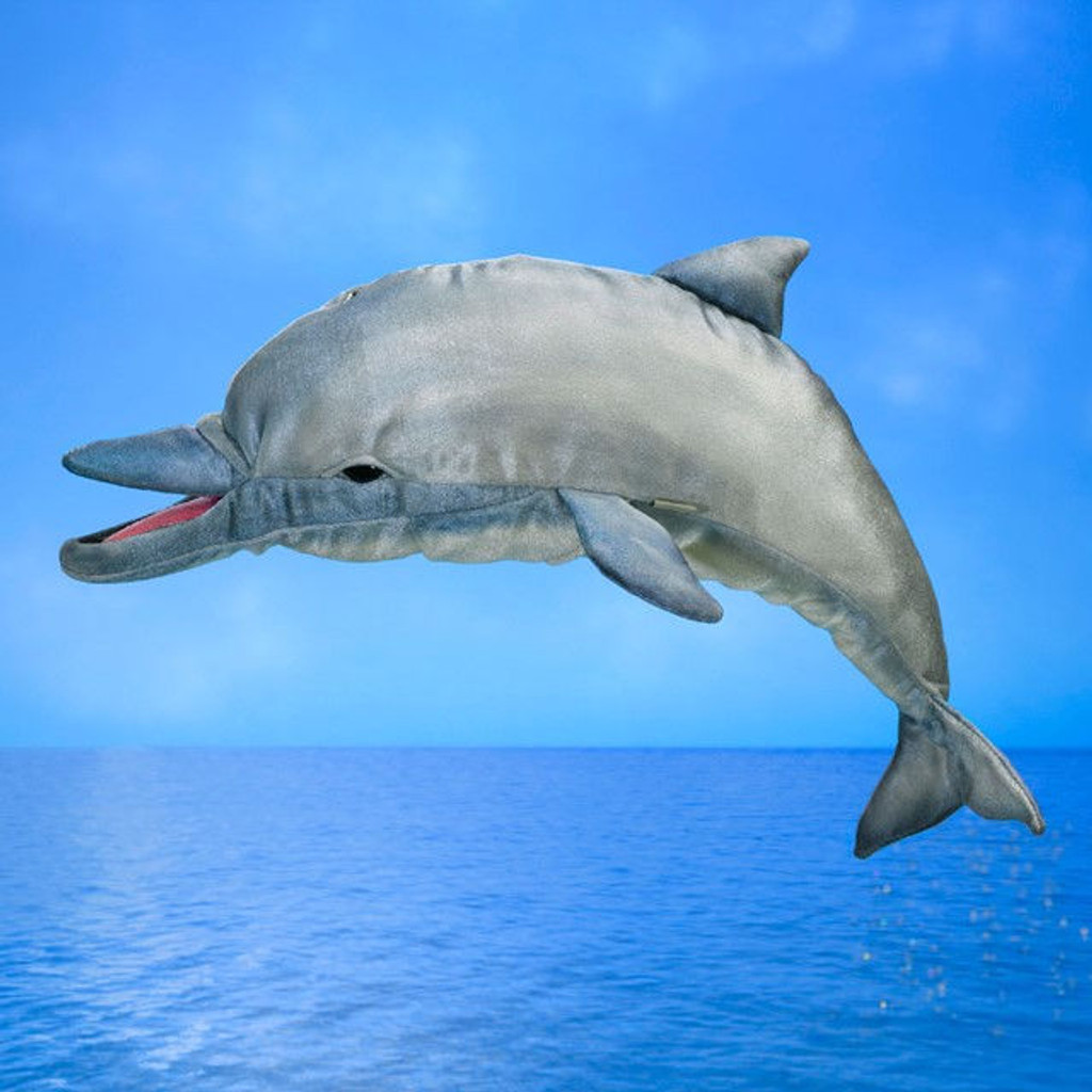 Folkmanis Whistling Dolphin Puppet leaping over ocean