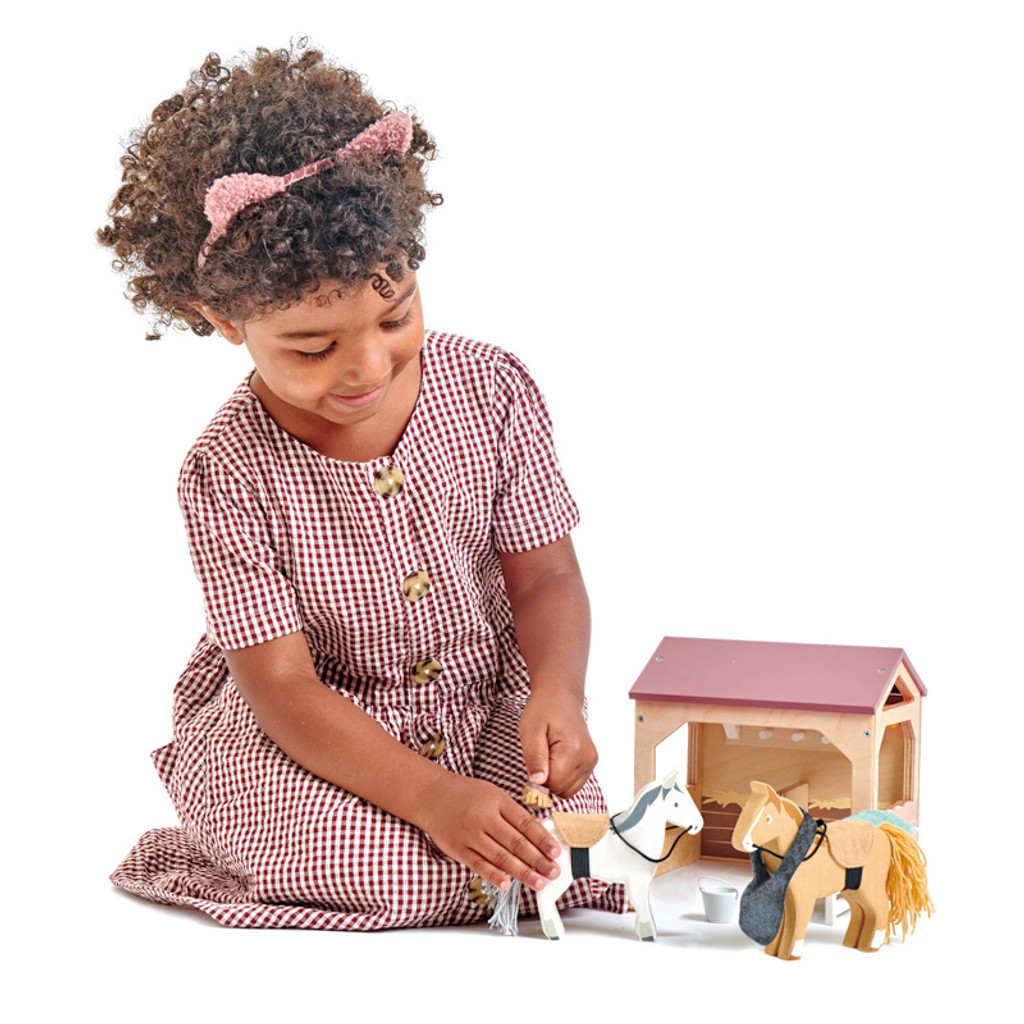 Tender Leaf Toys The Stables horse set with girl playing brushing horse hair