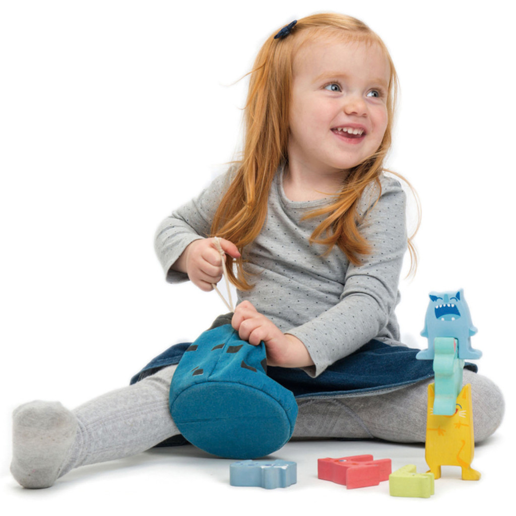Tender Leaf Toys Monster Stackers with Bag girl playing