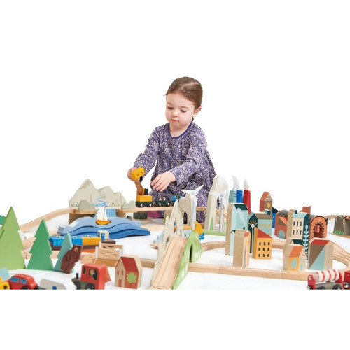 Girl playing with Tender Leaf Toys Mountain View Train Set