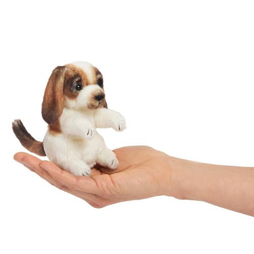 Folkmanis Mini Dog Finger Puppet on a hand