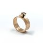 14K Rose Gold Ring With A Diamond Set In 14K White Gold