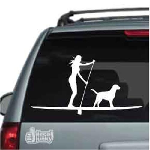 Girl Paddleboarding With Dog