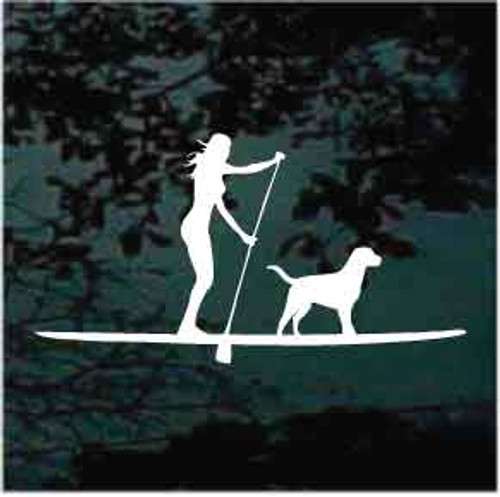Girl Paddleboarding With Dog