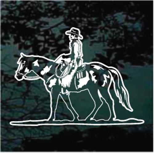 Cowboy Riding Paint Horse