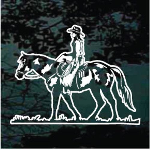 Cowgirl Riding Paint Horse