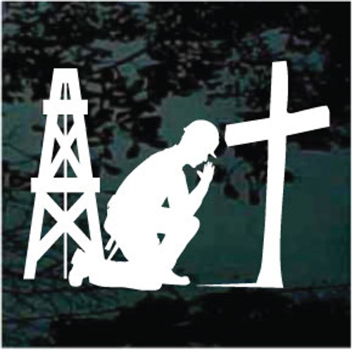 Christian Oil Rigger Praying at the Cross